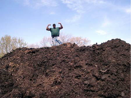 Will Allen atop a Growing Power compost pile