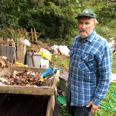 Joe, standing by his compost screening operation, speaks about the importance of worms in compost and soil fertility.