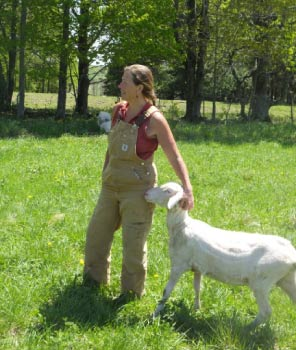 Maryrose enjoys a fine day with her sheep.