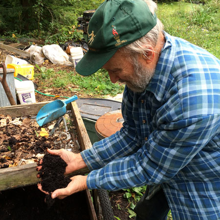 Joe shows the screened worm casting compost that can be applied to his garden.