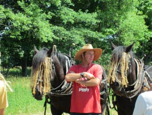Donn Hewes teaching about draft horses with one of the farm's teams.