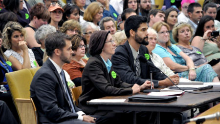 photo courtesy NOFA/Mass NOFA/Mass staff Amie Lindenboim & Marty Dagoberto (at microphone) at state GMO labeling bill hearing