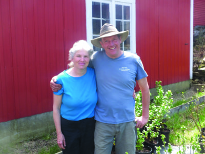 John and Nancy with black currant plants