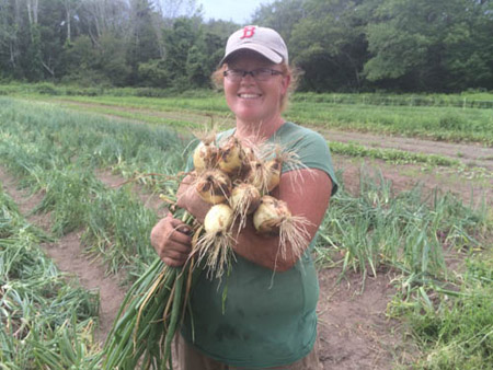 Laura with some of her spectacular onion crop