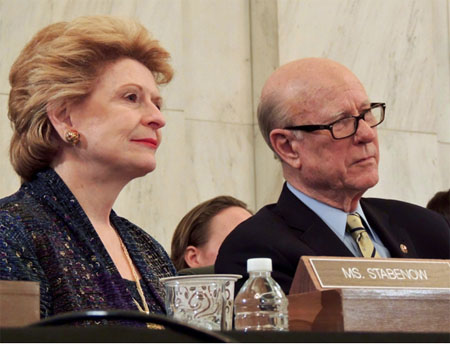 Ranking Senator Debbie Stabenow (D. Michigan) and chair Pat Roberts (R. Kansas)  listen to Crisantes' testimony at hearing of Senate Agriculture Committee.